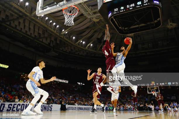 Joel Berry II of the North Carolina Tar Heels goes up for a shot against Lamont Walker of the Texas Southern Tigers in the first half during the...