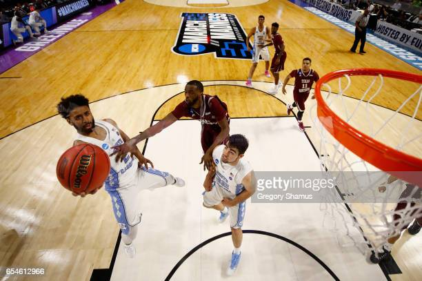 Joel Berry II of the North Carolina Tar Heels goes up for a shot against Marvin Jones of the Texas Southern Tigers in the second half during the...