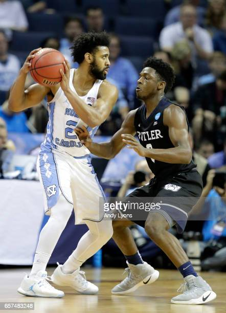 Joel Berry II of the North Carolina Tar Heels handles the ball against Kamar Baldwin of the Butler Bulldogs in the second half during the 2017 NCAA...