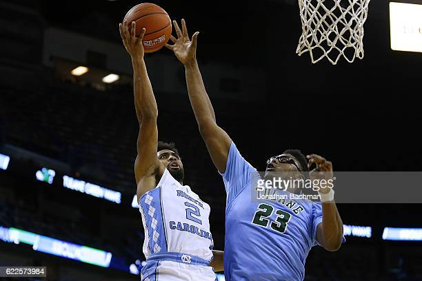 Joel Berry II of the North Carolina Tar Heels shoots against Blake Paul of the Tulane Green Wave during the second half of a game at the Smoothie...