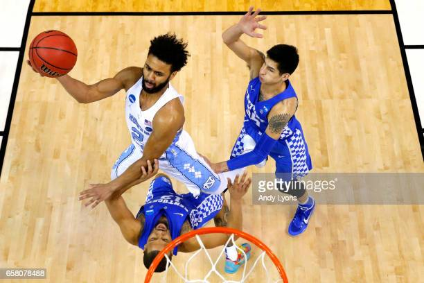 Joel Berry II of the North Carolina Tar Heels shoots against Isaiah Briscoe and Derek Willis of the Kentucky Wildcats in the second half during the...