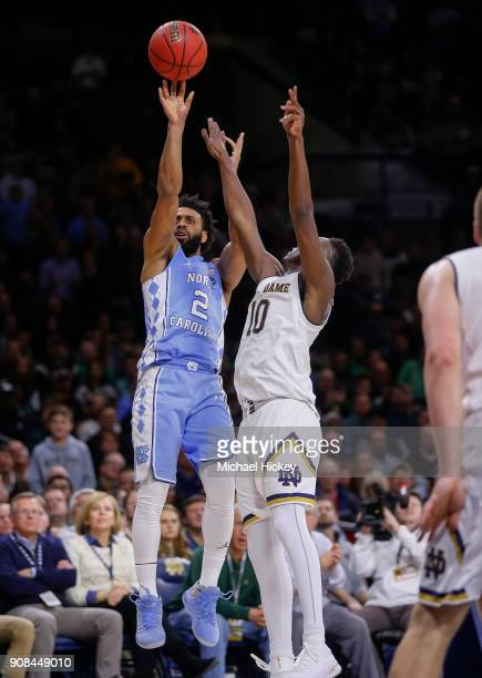 Joel Berry II of the North Carolina Tar Heels shoots the ball against TJ Gibbs of the Notre Dame Fighting Irish at Purcell Pavilion on January 13...