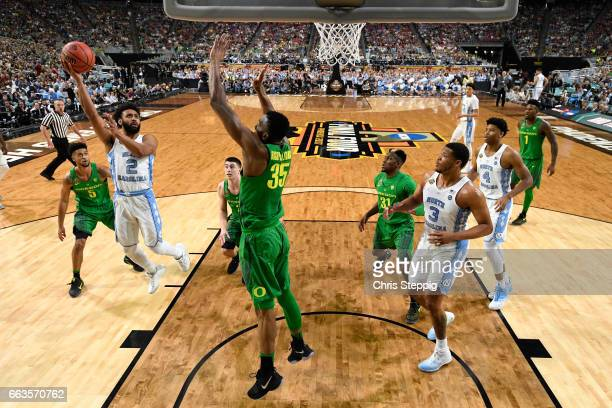 Joel Berry II of the North Carolina Tar Heels shoots the ball over Kavell Bigby-Williams of the Oregon Ducks during the 2017 NCAA Photos via Getty...