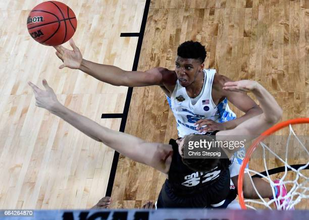 Joel Berry II of the North Carolina Tar Heels shoots the ball over Zach Collins of the Gonzaga Bulldogs during the 2017 NCAA Men's Final Four...