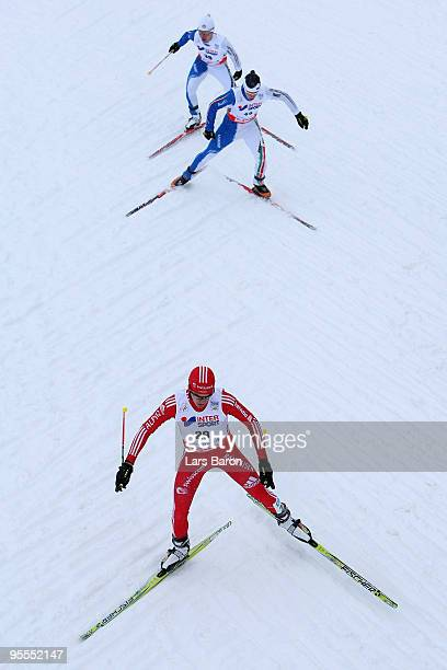 Joel Bierl of Switzerland competes infront of Armin Bauer of Italy and Davide Bresadola of Italy during the cross country event of the FIS Nordic...