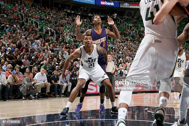 Joel Bolomboy of the Utah Jazz boxes out Marquese Chriss of the Phoenix Suns during a preseason game on October 12 2016 at Vivint Smart Home Arena in...