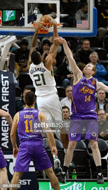 Joel Bolomboy of the Utah Jazz dunks past the defense of Tom Garlepp of the Sydney Kings in the second half of the 10883 win by the Jazz in their...