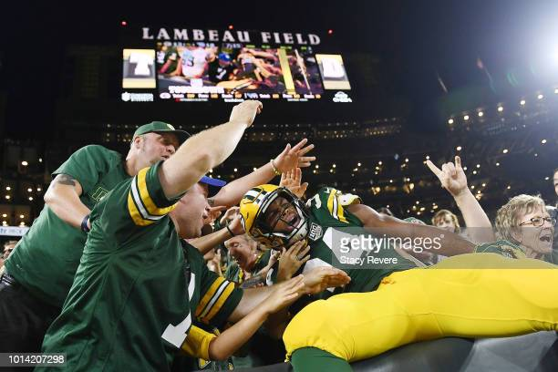 Joel Bouagnon of the Green Bay Packers celebrates a touchdown during the second half of a preseason game against the Tennessee Titans at Lambeau...