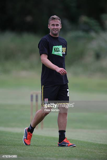 Joel Byrom of Northampton Town looks on during a 20/20 Cricket Match between Bold Dragoon CC and Northampton Town FC in aid of the Leon Barwell...
