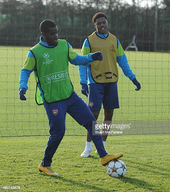 Joel Campbell and Chuba Akpom of Arsenal during a training session at London Colney on December 8 2014 in St Albans England