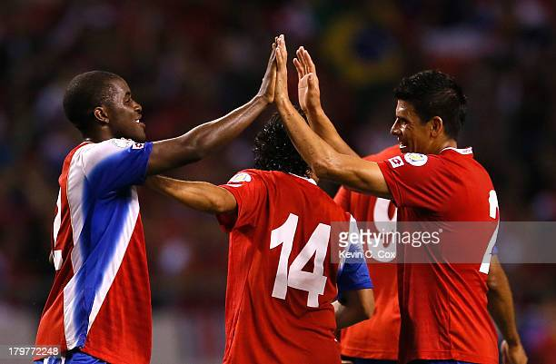 Joel Campbell and Johnny Acosta celebrate after their 31 win over the United States during the FIFA 2014 World Cup Qualifier at Estadio Nacional on...