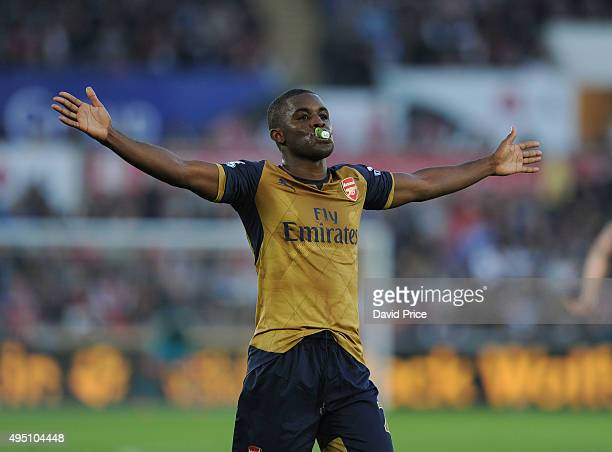 Joel Campbell celebrates scoring Arsenal's 3rd goal with a baby's dummy during the Barclays Premier League match between Swansea City and Arsenal at...