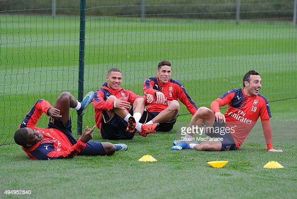 Joel Campbell Kieran Gibbs Gabriel and Santi Cazorla of Arsenal before a training session at London Colney on October 30 2015 in St Albans England