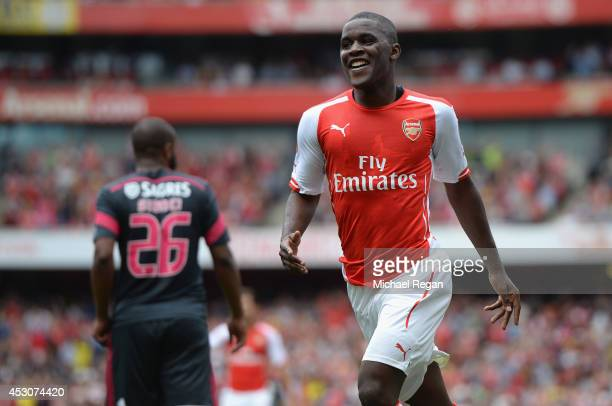 Joel Campbell of Arsenal celebrates scoring during the Emirates Cup match between Arsenal and Benfica at the Emirates Stadium on August 2 2014 in...