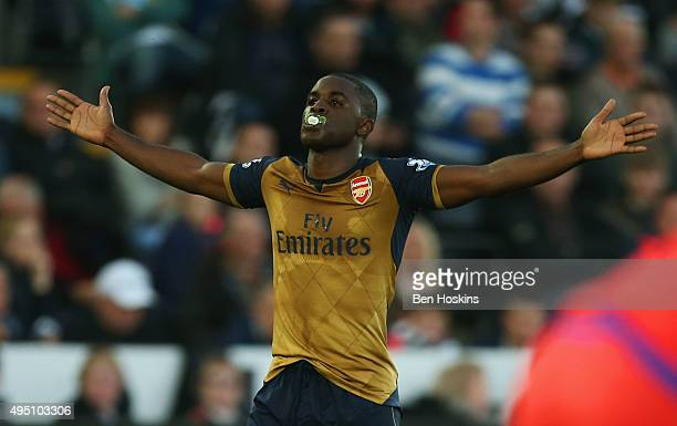 Joel Campbell of Arsenal celebrates scoring his team's third goal during the Barclays Premier League match between Swansea City and Arsenal at...