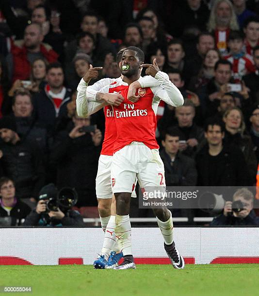 Joel Campbell of Arsenal celebrates scoring the opening goal with a baby dummy in his mouth during the Barclays Premier League match between Arsenal...