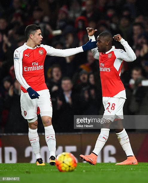 Joel Campbell of Arsenal celebrates with Gabriel after scoring the opening goal during the Barclays Premier League match between Arsenal and Swansea...