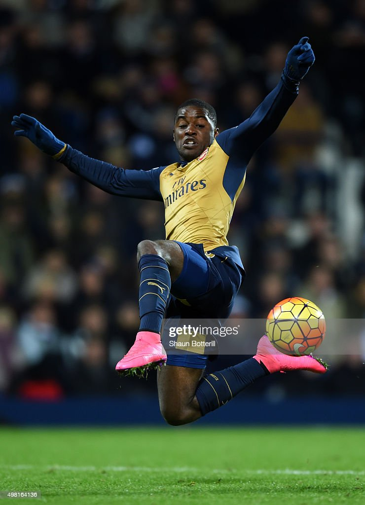 Joel Campbell of Arsenal dives for the ball during the Barclays Premier League match between West Bromwich Albion and Arsenal at The Hawthorns on November 21, 2015 in West Bromwich, England.