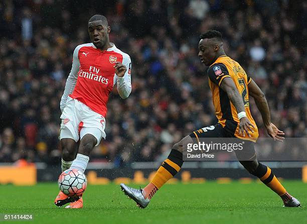 Joel Campbell of Arsenal passes the ball under pressure from Moses Odubajo of Hull during the match between Arsenal and Hull City in the FA Cup 5th...