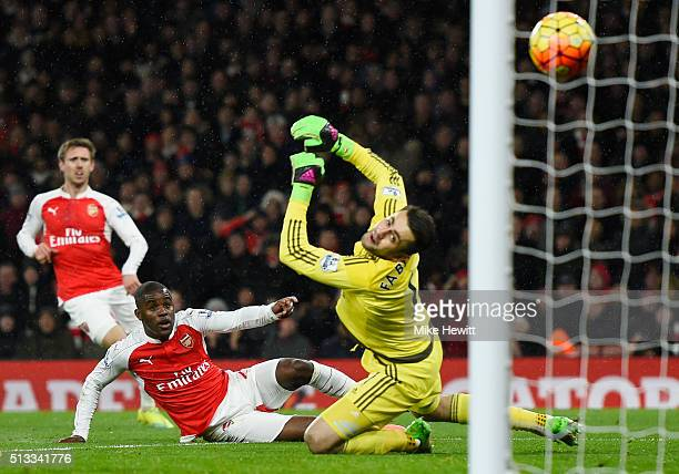 Joel Campbell of Arsenal scores the opening goal past Lukasz Fabianski goalkeeper of Swansea City during the Barclays Premier League match between...