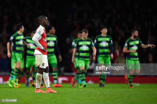 Joel Campbell of Arsenal stands dejected after Wayne Routledge of Swansea City scored the equalising goal during the Barclays Premier League match...