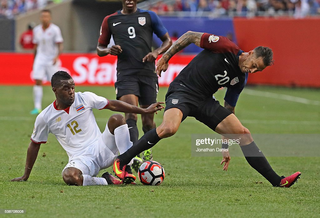 Joel Campbell #12 of Costa Rica and Geoff Cameron #20 of the United States battle for the ball during a match in the 2016 Copa America Centenario at Soldier Field on June 7, 2016 in Chicago, Illinois.