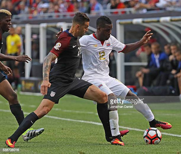Joel Campbell of Costa Rica and Geoff Cameron of the United States battle near the touchline for the ball during a match in the 2016 Copa America...