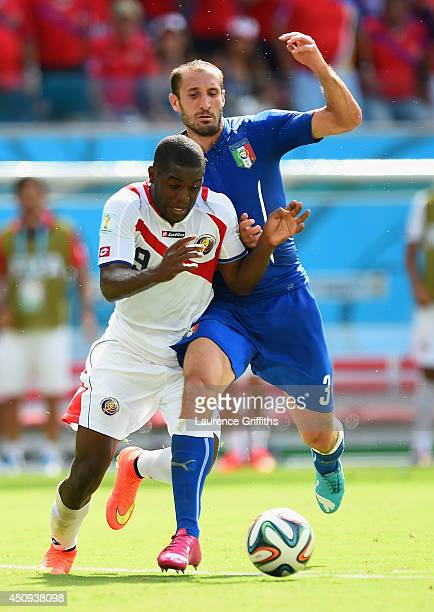 Joel Campbell of Costa Rica and Giorgio Chiellini of Italy compete for the ball during the 2014 FIFA World Cup Brazil Group D match between Italy and...