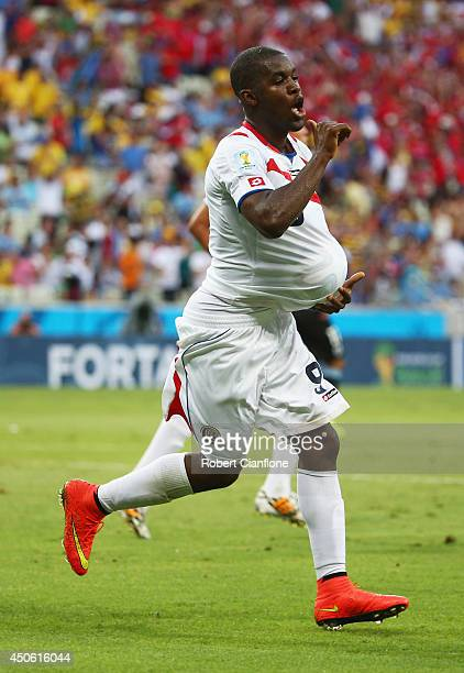 Joel Campbell of Costa Rica celebrates scoring his team's first goal with the ball under his jersey during the 2014 FIFA World Cup Brazil Group D...