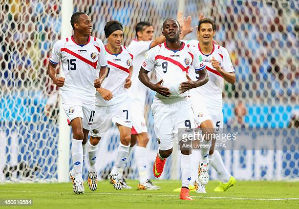 Joel Campbell of Costa Rica celebrates with teammates after scoring the team's first goal during the 2014 FIFA World Cup Brazil Group D match between...