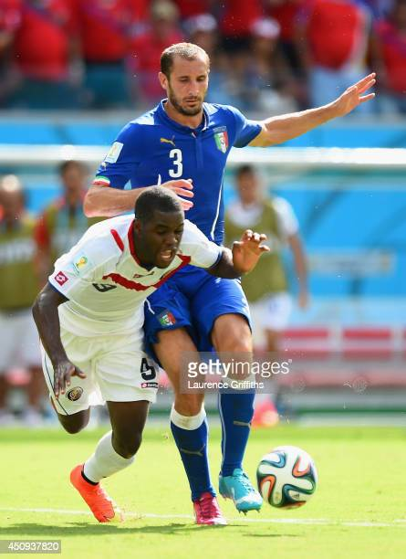 Joel Campbell of Costa Rica falls after a challenge by Giorgio Chiellini of Italy during the 2014 FIFA World Cup Brazil Group D match between Italy...