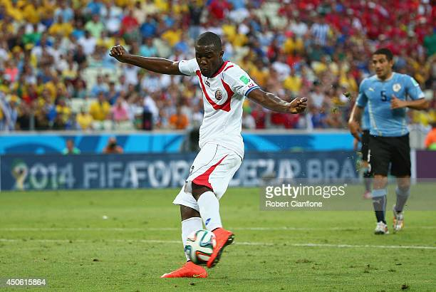Joel Campbell of Costa Rica shoots and scores his team's first goal during the 2014 FIFA World Cup Brazil Group D match between Uruguay and Costa...