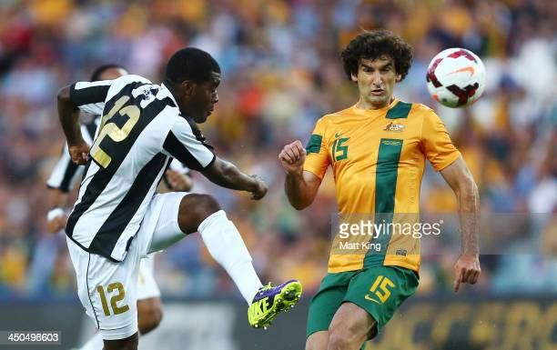 Joel Campbell of Costa Rica takes a shot at goal in front of Mile Jedinak of the Socceroos during the international friendly match between the...