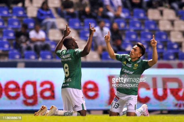 Joel Campbell of Leon celebrates his goal with his teammate Angel Mena during the Mexican Clausura 2019 tournament football match between Puebla and...