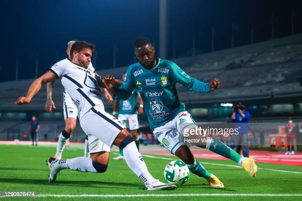 Joel Campbell of Leon struggles for the ball against Andres Iniestra of Pumas UNAM during the Final first leg match between Pumas UNAM and Leon as...