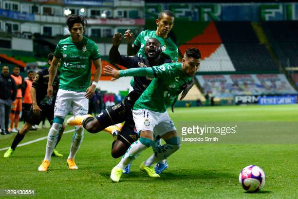 Joel Campbell of Leon struggles for the ball with Fernando Gorriaran and Alan Cervantes of Santos during the 16th round match between Leon and Santos...
