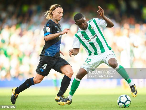 Joel Campbell of Real Betis Balompie being followed by Alexis Ruano of Deportivo Alaves during the La Liga match between Real Betis and Alaves at...