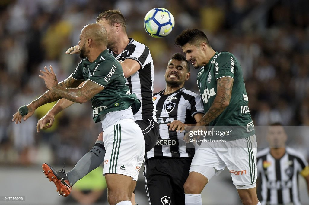 Joel Carli (C) and Brenner (C) of Botafogo struggles for the ball with Felipe Melo (L) and Bruno Henrique (R) of Palmeiras during the match between Botafogo and Palmeiras as part of Brasileirao Series A 2018 at Engenhao Stadium on April 16, 2018 in Rio de Janeiro, Brazil.