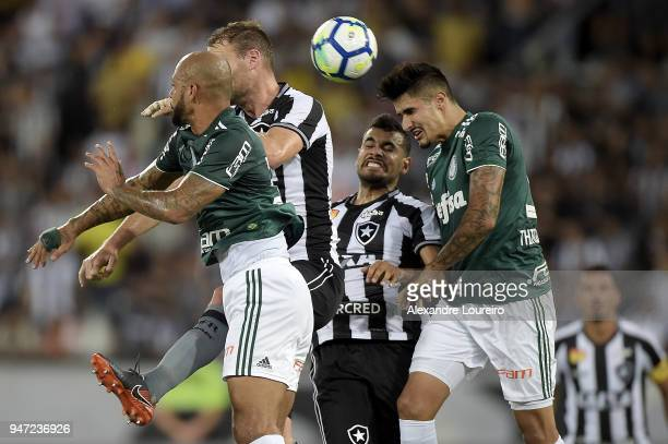 Joel Carli and Brenner of Botafogo struggles for the ball with Felipe Melo and Bruno Henrique of Palmeiras during the match between Botafogo and...