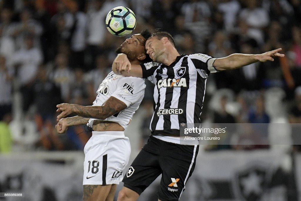 Joel Carli (R) of Botafogo battles for the ball with Kazim of Corinthians during the match between Botafogo and Corinthians as part of Brasileirao Series A 2017 at Engenhao Stadium on October 23, 2017 in Rio de Janeiro, Brazil.