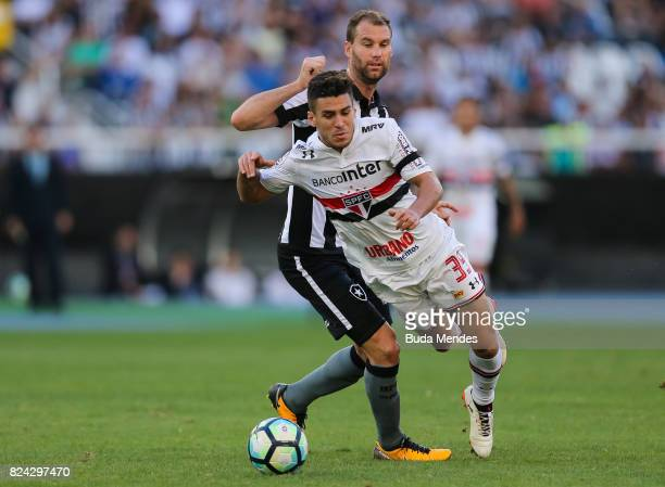 Joel Carli of Botafogo struggles for the ball with Marcinho of Sao Paulo during a match between Botafogo and Sao Paulo as part of Brasileirao Series...