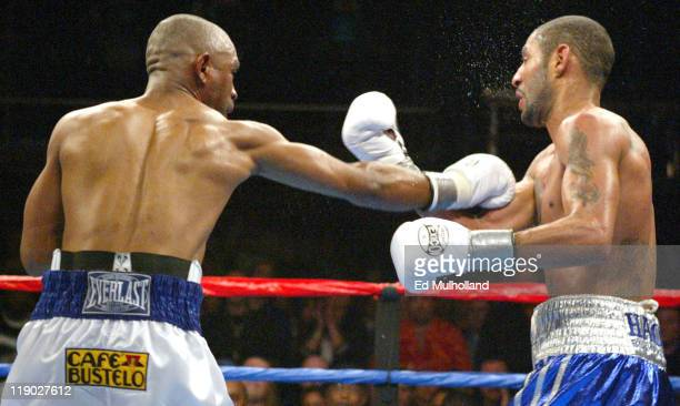 Joel Casamayor lands a right to the head of Diego Corrales during their bout at Foxwoods Casino Corrales captured the Junior Lightweight title with a...