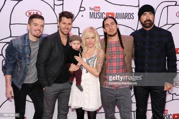 Joel Cassady Ryan Marshall Sarah Blackwood Gianni Luminati and Mike Tayler of Walk Off The Earth attend the 2013 YouTube Music awards at Pier 36 on...