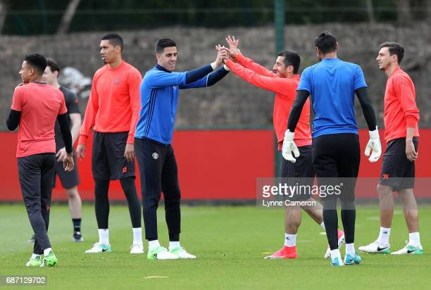 Joel Castro Pereira of Manchester United and Henrikh Mkhitaryan of Manchester United high five during a Manchester United training session ahead of...