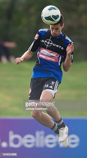 Joel Chianese heads the ball during a Sydney FC training session at Macquarie Uni on March 26 2013 in Sydney Australia