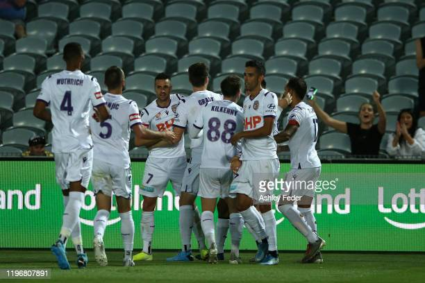 Joel Chianese of Perth Glory celebrates Perth's second goal with team mates during the round 12 A-League match between the Central Coast Mariners and...