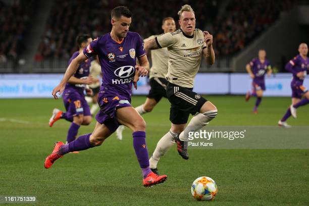 Joel Chianese of the Glory controls the ball against Phil Jones of Manchester United during the match between the Perth Glory and Manchester United...