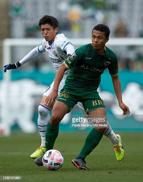 Joel Chima Fujita of Tokyo Verdy competes for the ball with Cayman Togashi of V-Varen Nagasaki during the J.League Meiji Yasuda J2 match between...