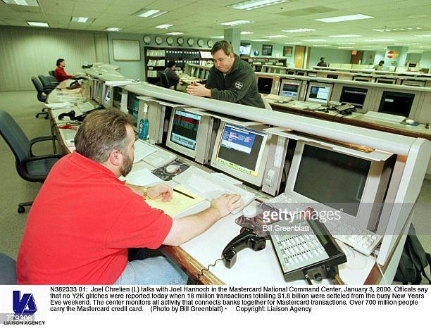 Joel Chretien talks with Joel Hannoch in the Mastercard National Command Center January 3 2000 Officals say that no Y2K glitches were reported today...