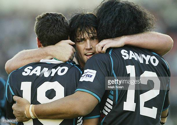 Joel Clinton embraces team mates Danny Galea and Tony Puletua after Danny Galea scored during the round twelve NRL match between the Penrith Panthers...